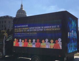 We cosponsored this rolling billboard and polling that shows 63% of West Virginians support a $15 minimum wage!